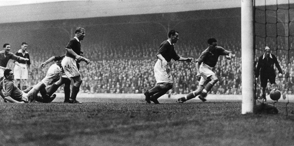 Liddell scores vs Portsmouth on the opening day of the 1953-54 season at Anfield. Liverpool recorded a 3-1 win which turned out only to be one of nine that season as Liverpool got relegated to the 2nd division.