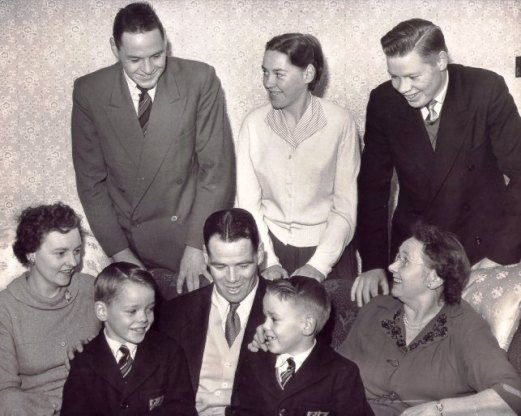 Billy has his and Phyllis' twins, David and Malcolm, on his knees. His and Rena's mother by his side. Above them are Alistair and twins Rena and George.