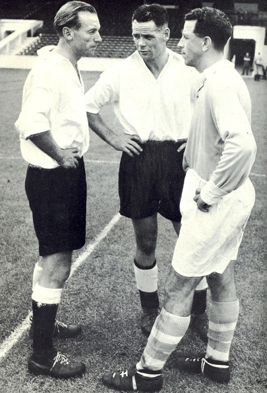 Billy with Sir Stanley Matthews (left) and Roy Paul (right) in a practice game at Maine Road prior to the match between Great Britain and the Rest of Europe in Belfast in 1955.