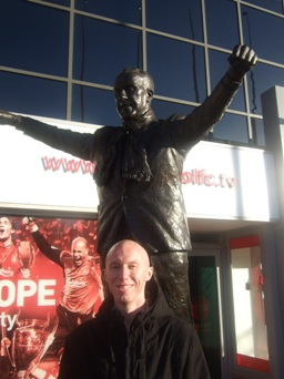 The author, John Hynes, in front of the Shankly statue