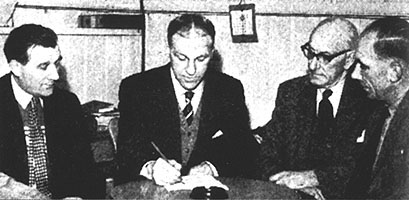 Bill signs for Liverpool with Paisley on the left and TV Williams on the right