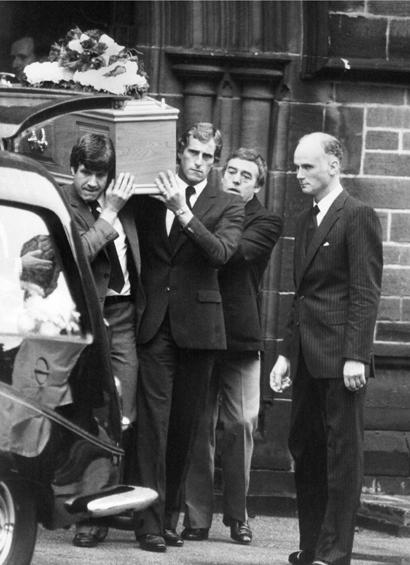 Emlyn Hughes, Ray Clemence and Ian St John carrying Shanks' coffin